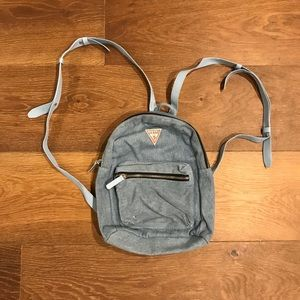 GUESS: blue jean backpack purse